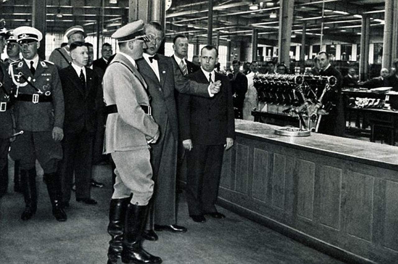 33-hitler-receives-a-tour-of-the-bmw-ag-manufacturing-plant-by-chief-executive-franz-josef-popp-in-1936